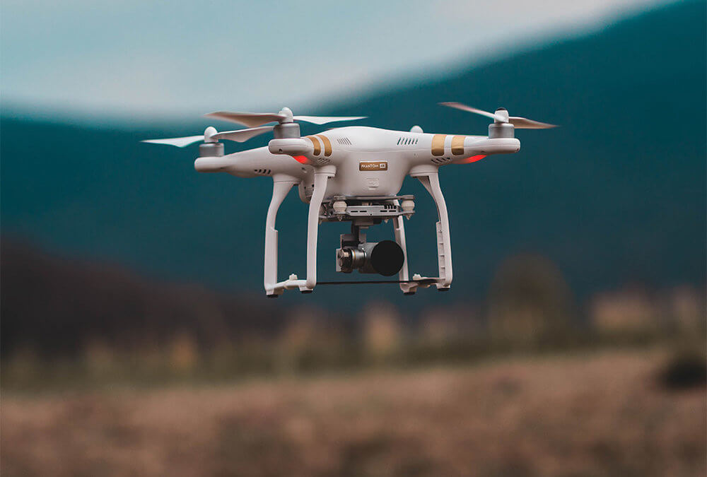 Why use drones to conduct aerial surveys?